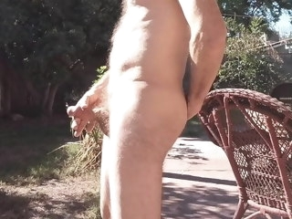playing Playing with my dick outside in the sun dick