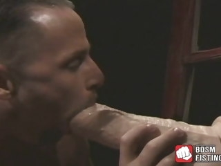 muscular Muscular gay slobbers on a massive dildo before riding it gay