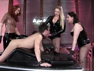 three three latex mistresses fuck a slave latex